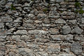 Ancient castle wall cu detail of with stones and rocks exposed showing method of mortar joints used thousand years ago Royalty Free Stock Images