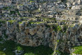 Ancient cave dwellings looking at the amazing dwelling village of sassi di matera across a steep ravine sassi di matera is in Royalty Free Stock Photo