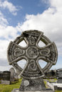 Ancient celtic cross against in Irish cemetary