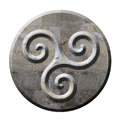 Ancient celtic triskele symbol in stone Stock Photos