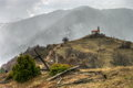 Ancient chappel at rhodopes mountain on the background is snowing Royalty Free Stock Image