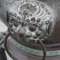 Ancient chinese lion doorknob outside of a buddha monument Stock Photos