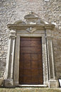 Ancient church front door big old and stone wall Royalty Free Stock Photography