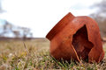 Ancient clay pot is split in the field. Tile age-old abandoned. Clay pot is broken Royalty Free Stock Photo