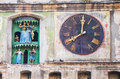 Ancient clock on a medieval church Stock Photos