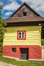 An ancient colorful house in the Vlkolinec village.