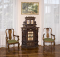 Ancient Commode and chairs, late 19th century Royalty Free Stock Photo