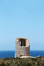Ancient costal watchtower capo rama sicily the ruins of an against the sea in a windy day from near palermo portrait cut Stock Photography
