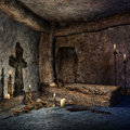 Ancient crypt with a wooden coffin candles and bones Royalty Free Stock Photo