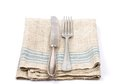 Ancient cutlery on linen Stock Photography
