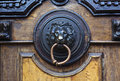 An ancient door handle with metal lion head in Tbilisi, Georgia Royalty Free Stock Photo