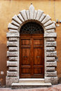 Ancient wooden door of a historic building in Perugia (Tuscany, Italy) Royalty Free Stock Photo