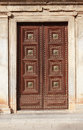 Ancient door stone building with nice wooden Royalty Free Stock Photo