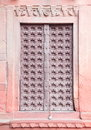 Ancient door on wall of red fort agra india Royalty Free Stock Image