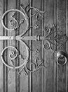 Ancient door with a wrought iron decoration italy Stock Photo