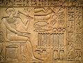 Ancient egyptian hieroglyph depicting a pharaoh animals and signs Stock Photo