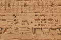 Ancient egyptian hieroglyphs on a wall of the karnaksky temple karnak temple — the largest temple complex of egypt the Stock Image