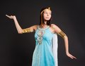 Ancient egyptian woman cleopatra pretty in queen costume at black background Stock Image
