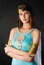 Ancient egyptian woman cleopatra pretty in queen costume at black background Royalty Free Stock Photo