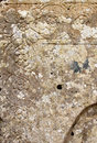 Ancient engraved stone detail a detailed view of an with lichens from erice near trapani sicily portrait cut Stock Photo