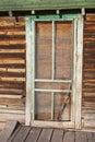 Ancient exterior screen door log cabin boards retro Royalty Free Stock Photo