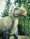 Ancient extinct dinosaur on a background of plants Royalty Free Stock Image
