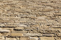 Ancient floor made of stone bricks shot from a slightly high angle thus creating diminishing perspective towards the vanishing Royalty Free Stock Photography