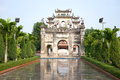 Ancient gate of a buddhist temple in snake village le mat snake village hanoi vietnam early morning Stock Images