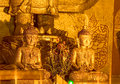 Ancient golden buddha statue in ananda temple old bagan myanmar covered with small golden flakes Royalty Free Stock Image