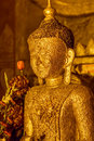 Ancient golden buddha statue in ananda temple old bagan myanmar covered with small golden flakes Royalty Free Stock Photo