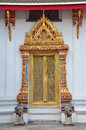 Ancient golden carving door of thai temple in bangkok thailand Royalty Free Stock Image