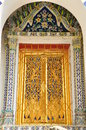 Ancient golden carving door of thai temple in bangkok thailand Stock Image