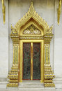 Ancient golden carving wooden door of thai temple in bangkok thailand Royalty Free Stock Images
