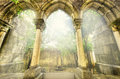 Ancient gothic arches in the myst. Fantasy landscape in Evora, Portugal. Royalty Free Stock Photo