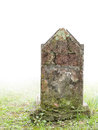 Ancient gravestone in fog. Old, stone.