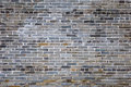 Ancient gray brick wall Royalty Free Stock Photo