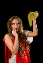 Ancient greece woman with a bunch of grapes godness isolated on black background Stock Photography
