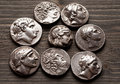 Ancient greek coins on a wooden table Royalty Free Stock Photo