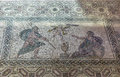 Ancient Greek floor mosaic in archaeologic park Kato Paphos, Cyprus. Royalty Free Stock Photo