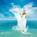 Ancient greek goddess in sea waves aphrodite styled woman splashing dress walking on water collage Stock Images