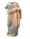Ancient greek headless statue of a woman dressed with typical cl