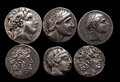 Ancient greek silver coins with portraits of rulers and gods Royalty Free Stock Photo