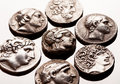 Ancient greek silver coins on reflective surface Royalty Free Stock Photo