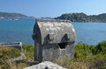 Ancient greek tomb overlooking the sea on a clear day in apollonia lyzia southern turkey Royalty Free Stock Photo