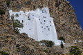 Ancient hillside monastery brilliant white and historic of panagia hozoviotissa along the cliffs of amorgos island greece Stock Images