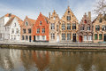 Ancient houses at a canal in bruges line of colourful water west flanders the flemish region of belgium Stock Photography
