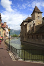 Ancient houses on the channel annecy france antique prison in town a bright sunny day Stock Image