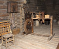 Ancient interior of the room of the weaver in a wooden log hut, Russia Royalty Free Stock Photo