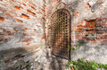 Ancient iron door decorated with wrought iron details entrance to the abandoned russian church Royalty Free Stock Image