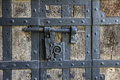 Ancient iron lock with latch on aged boarded door in wurzburg germany Royalty Free Stock Images